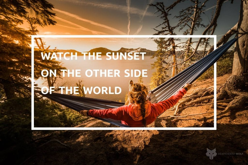 girl in hammock and travel quote