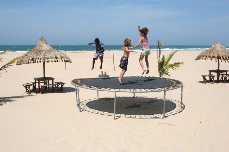 Three childrens on trampoline