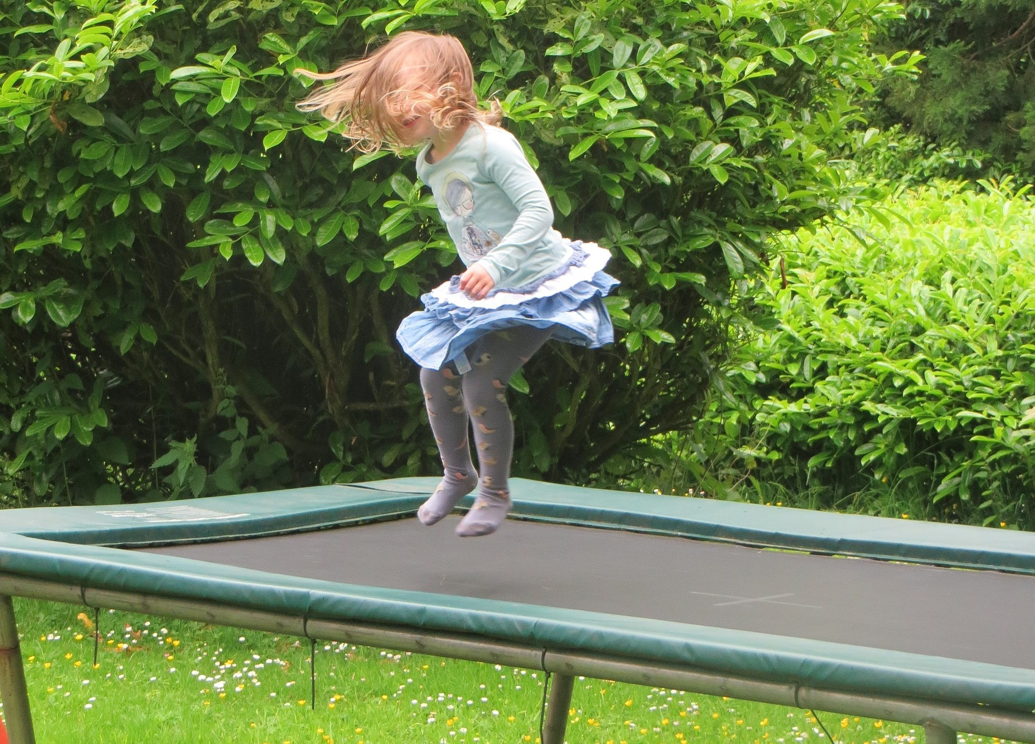 a girl bouncing on one of the best rectangular trampolines