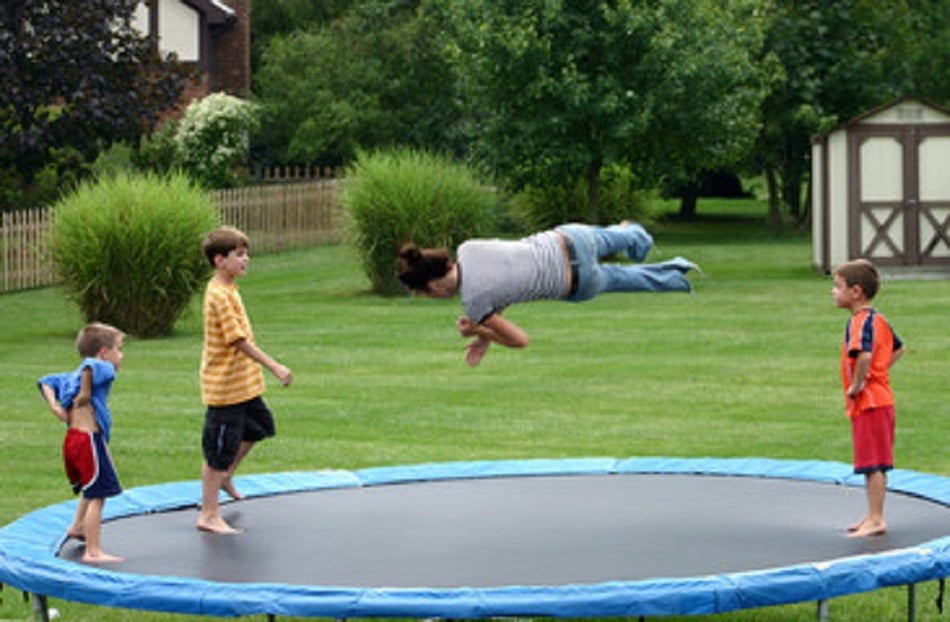 a group of kids doing trampoline tricks