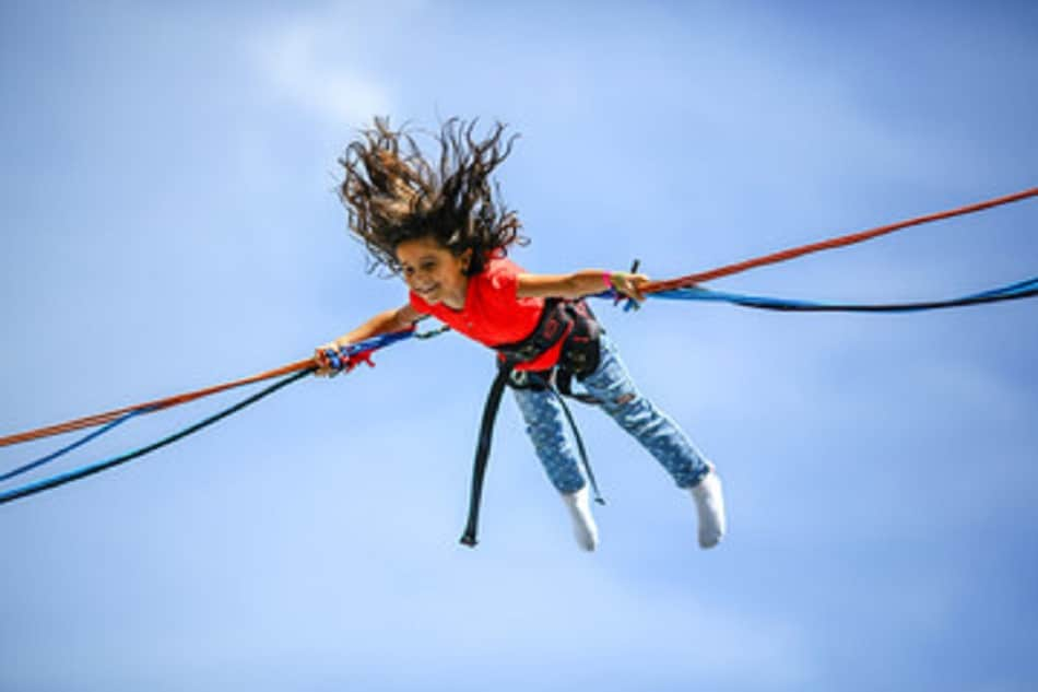 a girl jumping and doing trampoline tricks