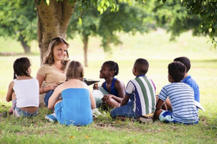 outdoor reading with the kids under a tree