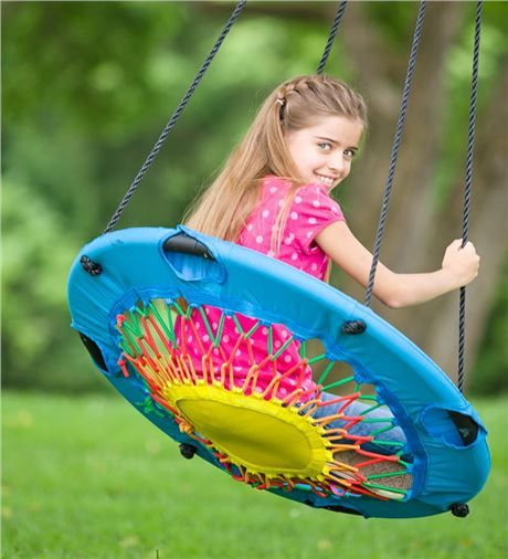 girl on a swinging trampoline chair