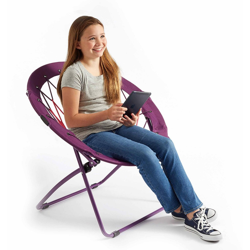 girl sitting on trampoline chair