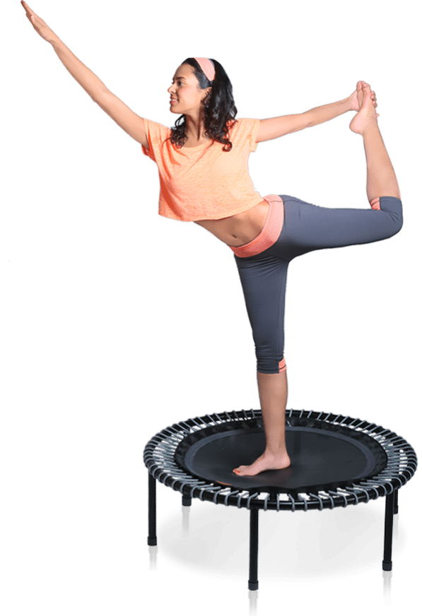 woman doing yoga and balancing on a trampoline