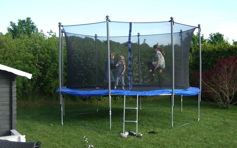 Kids playing in the trampoline