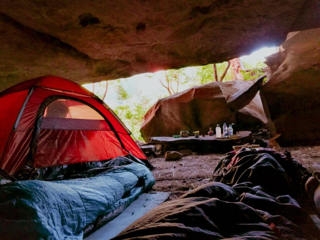 Sleeping bag and other camping gear under the cave