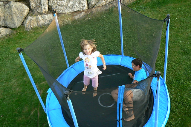 two kids in a Trampoline having fun