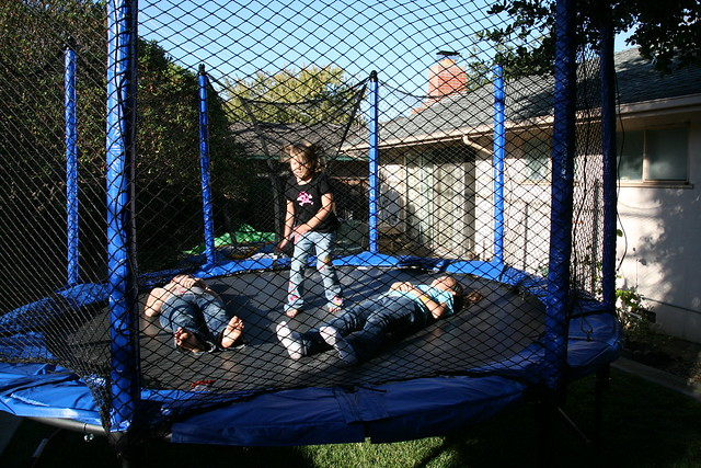 3 girls playing inside a trampoline