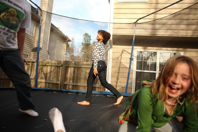 3 kids having fun inside a trampoline