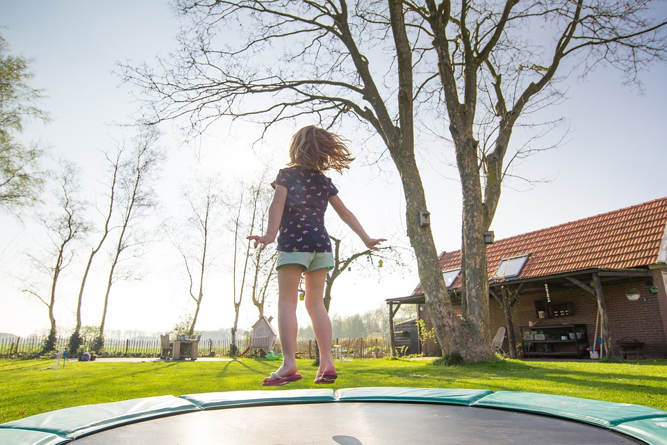 A girl jumping on a Trampoline