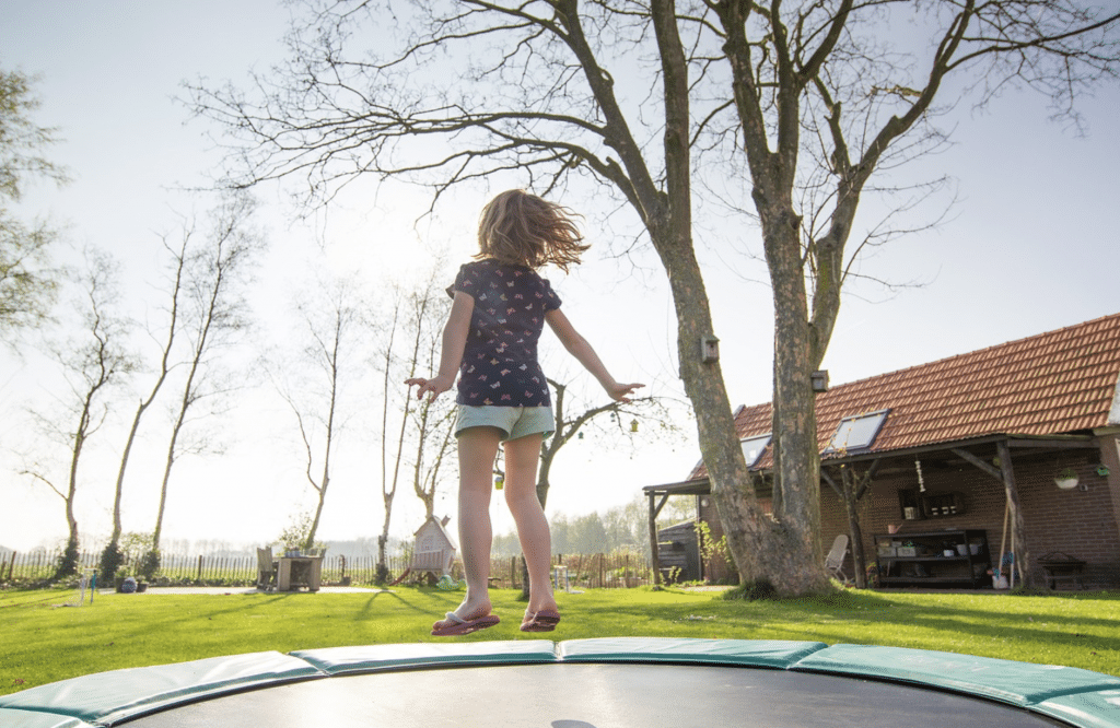 girl jumping on the trampoline