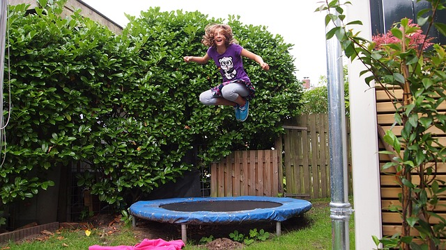 girl jumping at the trampoline